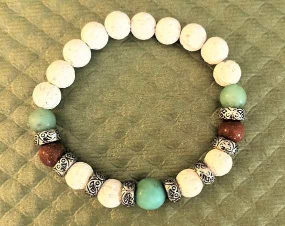 Gemstone Aroma Therapy Bracelet using White Lava Rock for the Essential Oils.