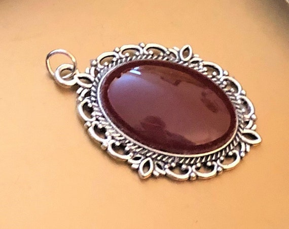 Carnelian Cabochon encased in a Silver Plated Setting.