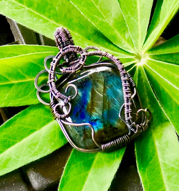 """Flashy Labradorite Cabochon lovingly wrapped in Oxidized Copper Wire.  Labradorite property is """"Bringer of Light"""""""
