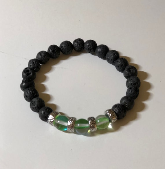Aroma Therapy Bracelet made with Green Irridescent Beads and Lava Rock Beads.