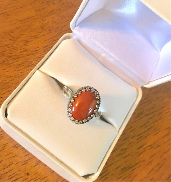 Red Jasper adjustable ring  is designed around a 10 x 14 mm gemstone in a silver-plated crown bezel.