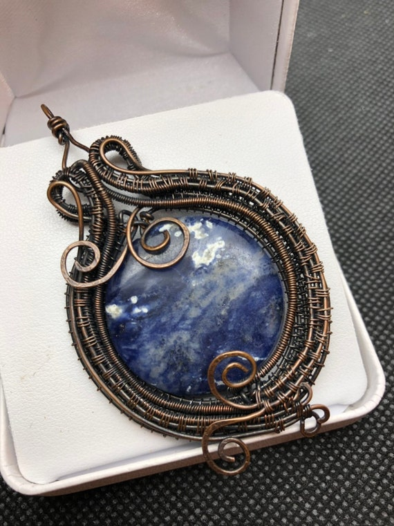 Sodalite with Antiqued Copper Wire Weave.   Sodalite properties are Intelligence, Truth, Self-Esteem
