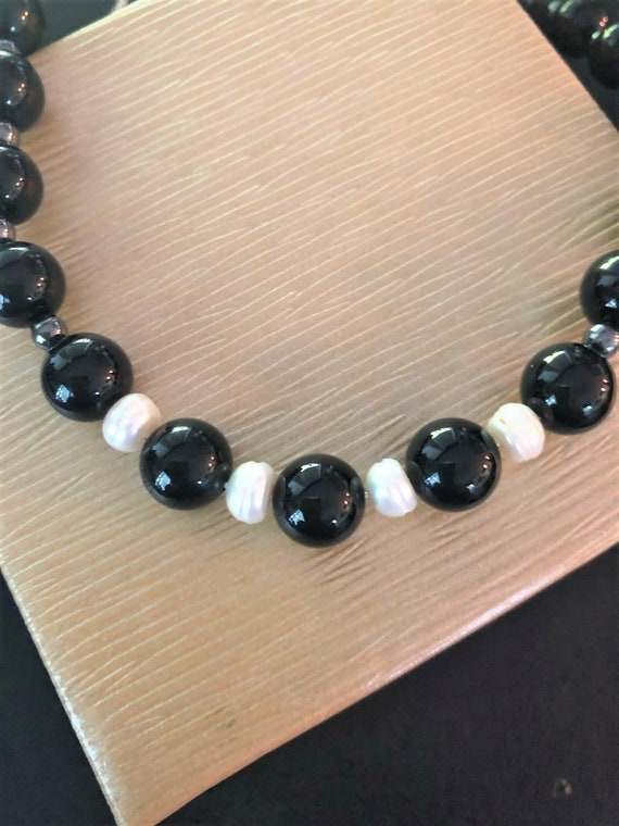 Black Onyx and Fresh Water Pearl Necklace on Sterling Silver Island and Chain with Hematite Spacer Beads.