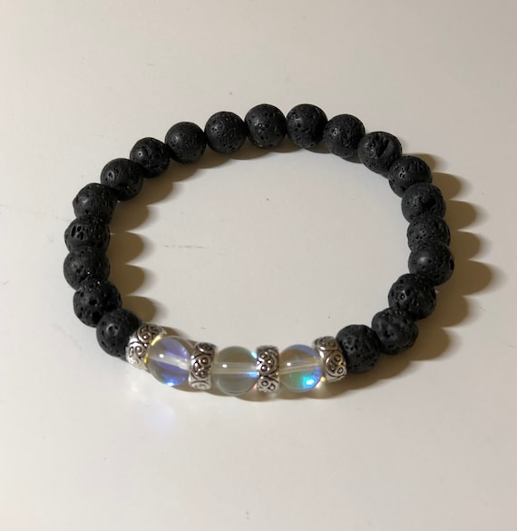 Aroma Therapy Bracelet made with Blue Irridescent Beads and Blue Lava Rock Beads.