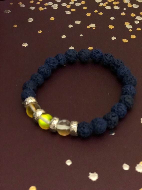 Aroma Therapy Bracelet made with Yellow Irridescent Beads and Blue Lava Beads.