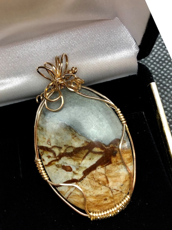Mountainscape in Picture Jasper awaiting her new home.  Wire wrapped in 14K Gold Filled Wire.