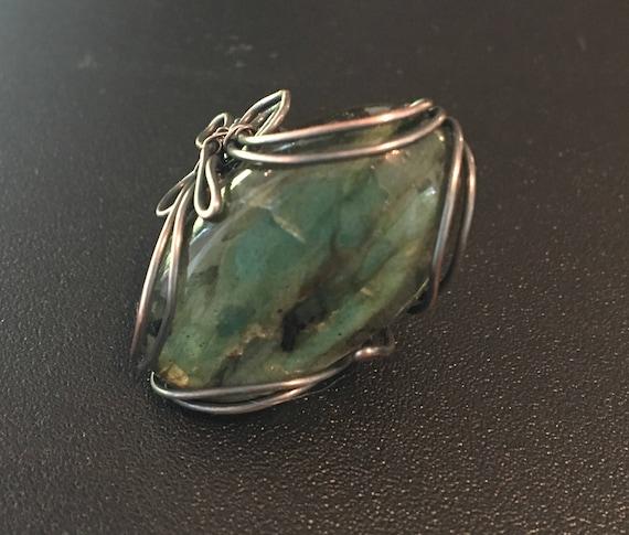 "Antiqued Labradorite Ring.   Labradorite property is ""Bringer of Light"""