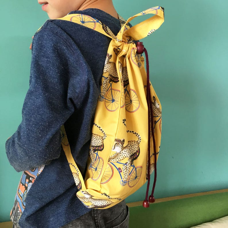 Kids Backpack-Cheeta on race bike yellow image 0