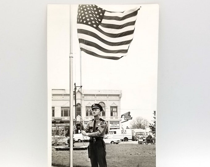Photograph of the lowering of the flag at the Polk County (Dallas, Oregon) courthouse on Nov. 22, 1963 - Kennedy Assassination