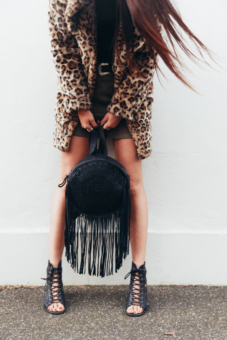 fringed leather backpack in black
