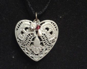Elegant Silver Heart Pendant with accents