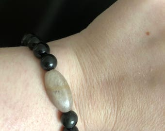 Onyx bracelet with center bead