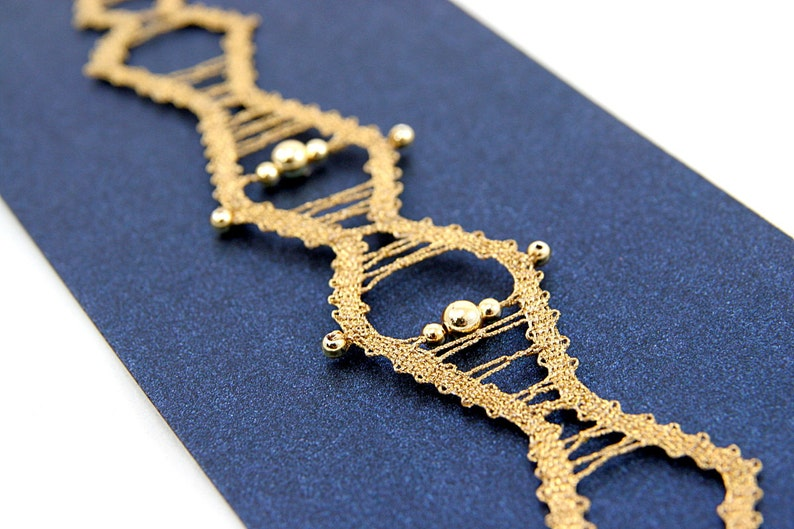 Golden Bobbin Lace Bracelet shaped like the dragon tail with image 0