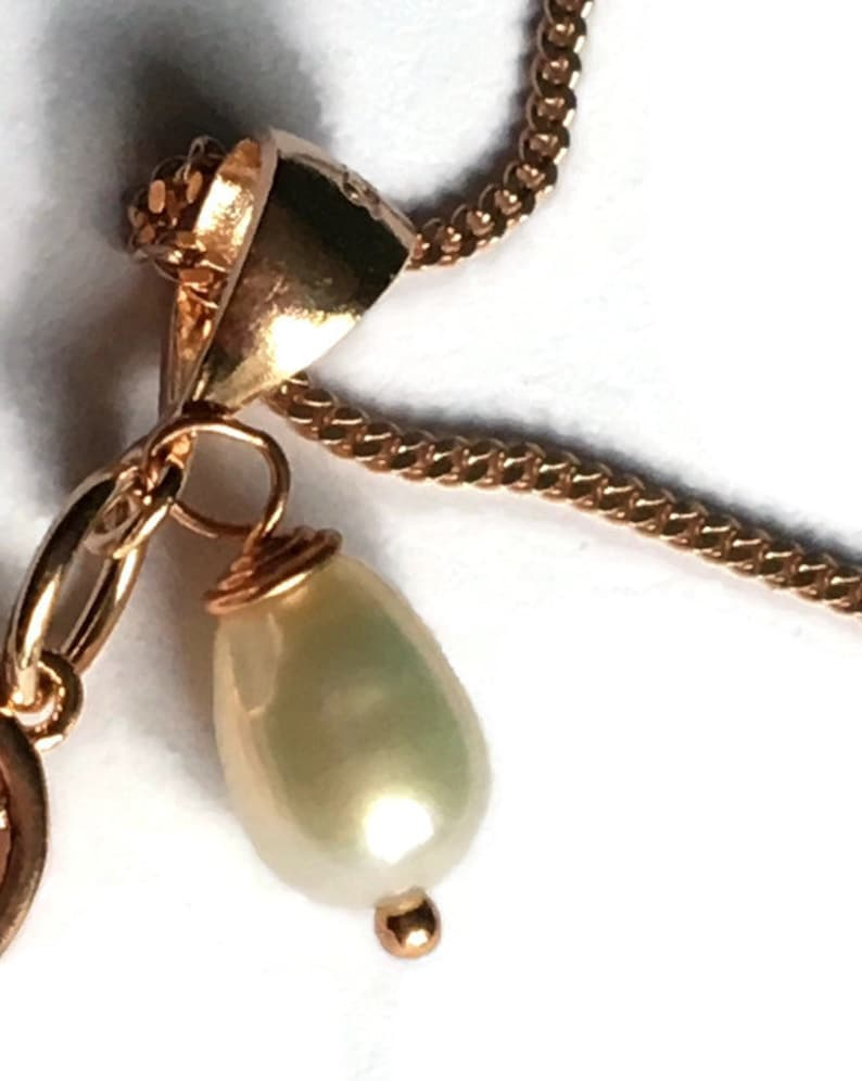Angel wing and pearl pendant