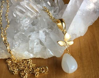Moonstone and orchid pendant