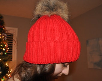 Trendy popular selling. Winter hat with fur, high fashion, trendy,Red Cotton Thick Female Beanie Cap With Fur ball