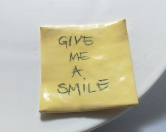 GIVE ME A SMILE