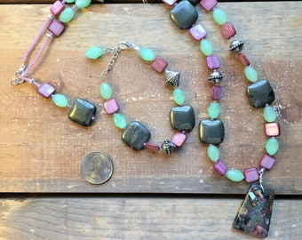 Shape and texture with a blend of cool and striking colors, Copper Turquoise pendant, Pyrite squares with pink shell and Aquamarine barrels