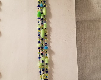 Green beaded bracelet with toggle clasp