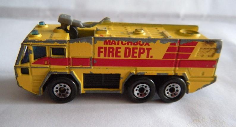 Mixed Assortment of ERTL Hot Wheels Matchbox Metal Cars Trucks Plane and More