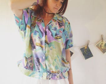 Vintage clothing. 1970s rainbow colorful blouse