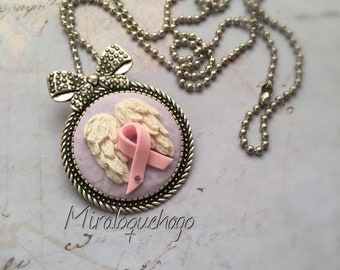 Wings necklace with pink bow