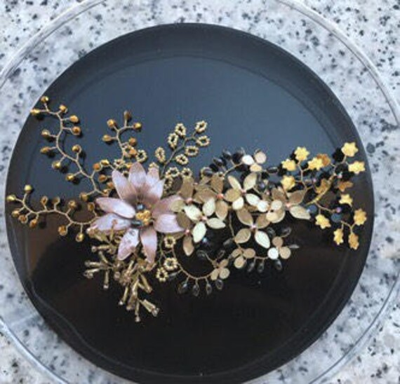 Headdress, range of golds and black