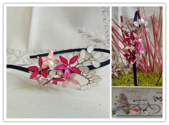 """Touched with """"bouquet of enamelled flowers"""", on headband lined in satin."""