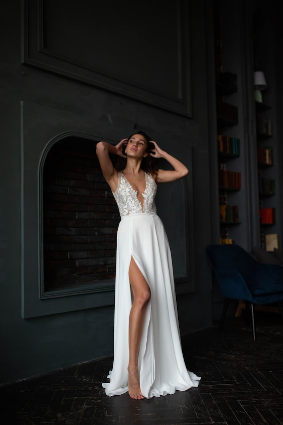 Simple lace wedding dress with nude bodice, plunging v neckline, open back, slit chiffon skirt, A-line silhouette, tulle bodice, ivory gown by Our Stories Bridal, Etsy