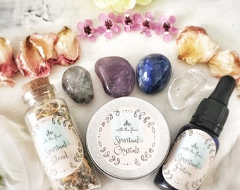 Spiritual crystals, herbal blend and potion.
