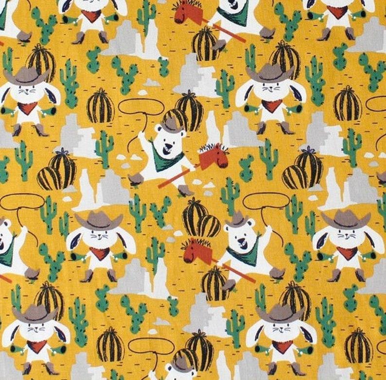 0,50m Baumwolljersey W\u00fcsten Cowboys senfgelb gelb Senf beige M\u00e4dchenstoffe Jungsstoffe Jungen M\u00e4dchen Waldtiere Tiere Stoff Jersey