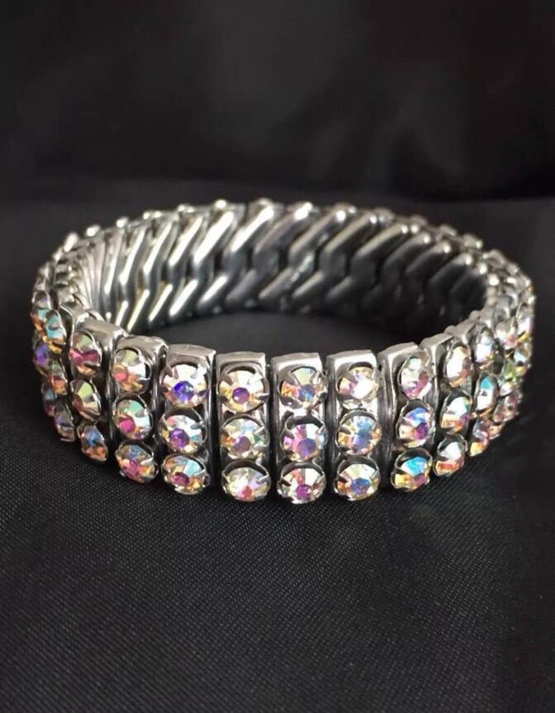 Glamorous 1950s silver tone rhinestone diamant\u00e9 aurora borealis cuff bracelet pin up