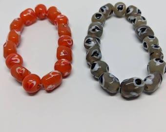 bracelets; quirky bracelet; heart bead bracelet; heart bracelet; beaded bracelet; khaki; orange; statement bracelet