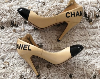 b23db4e695bd Vintage CHANEL Letters and CC Logo Beige Black Cap Toe Heels Pumps with  Chain detail eu 37.5 us 7 - 7.5 - Super RARE!!