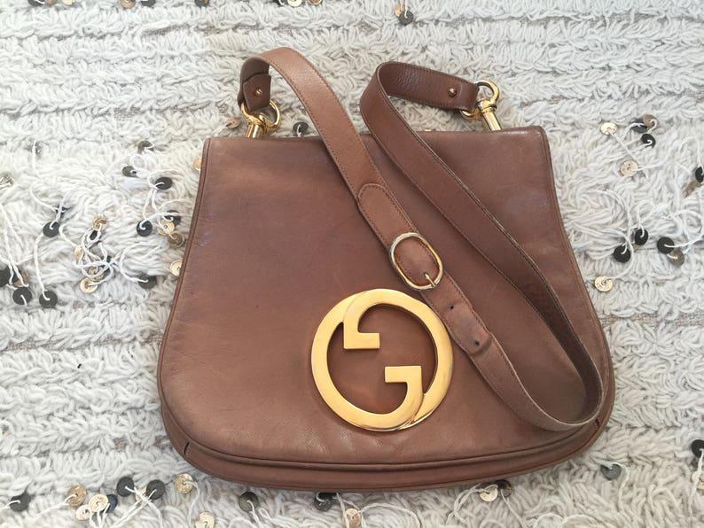 c562e7c7657a7 Vintage GUCCI Cognac Leather BLONDIE Brit 1973 Shoulder Crossbody Bag Purse  Huge Gold GG's - Rare!