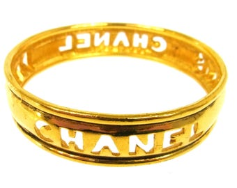 Vintage CHANEL PARIS Logos Letters Script Monogram Gold Charm Cuff Bangle Bracelet