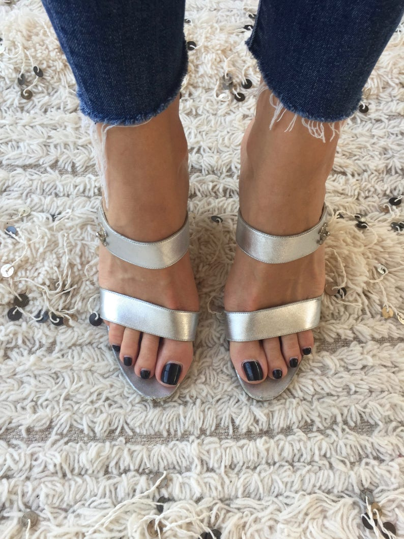 76c22fe39 Vintage CHANEL CC Turnlock Metallic Silver Leather Mules
