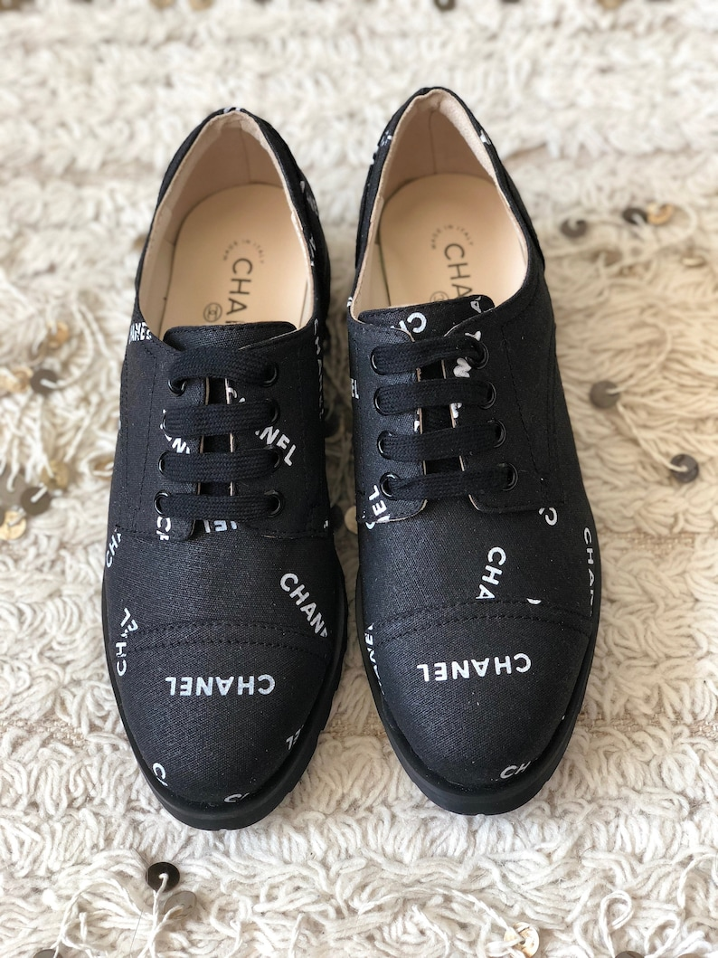 3767fb56dc0 Vintage CHANEL Letters Logo Cap Toe Black White Sneakers