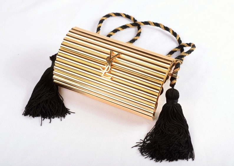 d3ddaa50209a Vintage ICONIC YSL Yves Saint Laurent Gold Metal Barrel Evening Clutch  Minaudiere Crossbody w Tassel