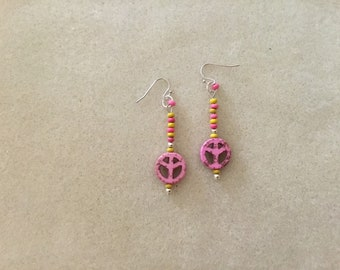 "2 & 1/4"" Dangle Peace Signs Earrings."