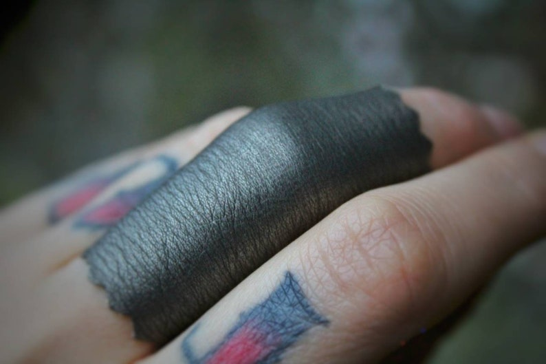 END Of The WORLD shiny silver stretch vegan leather ring