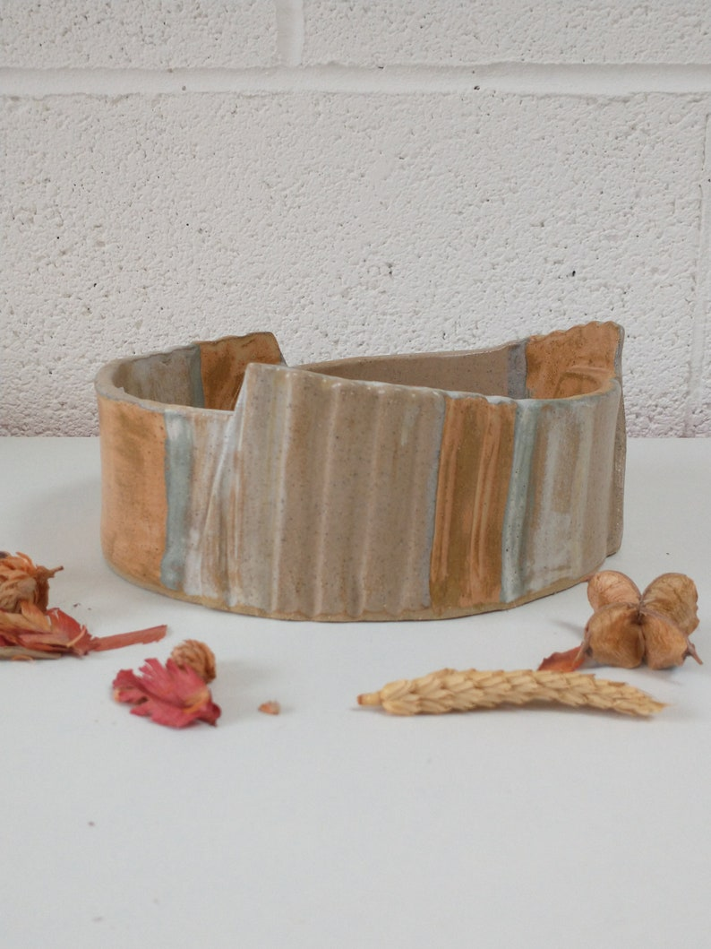 Burnt orange and cream glazed ceramic abstract bowl. An ideal image 0