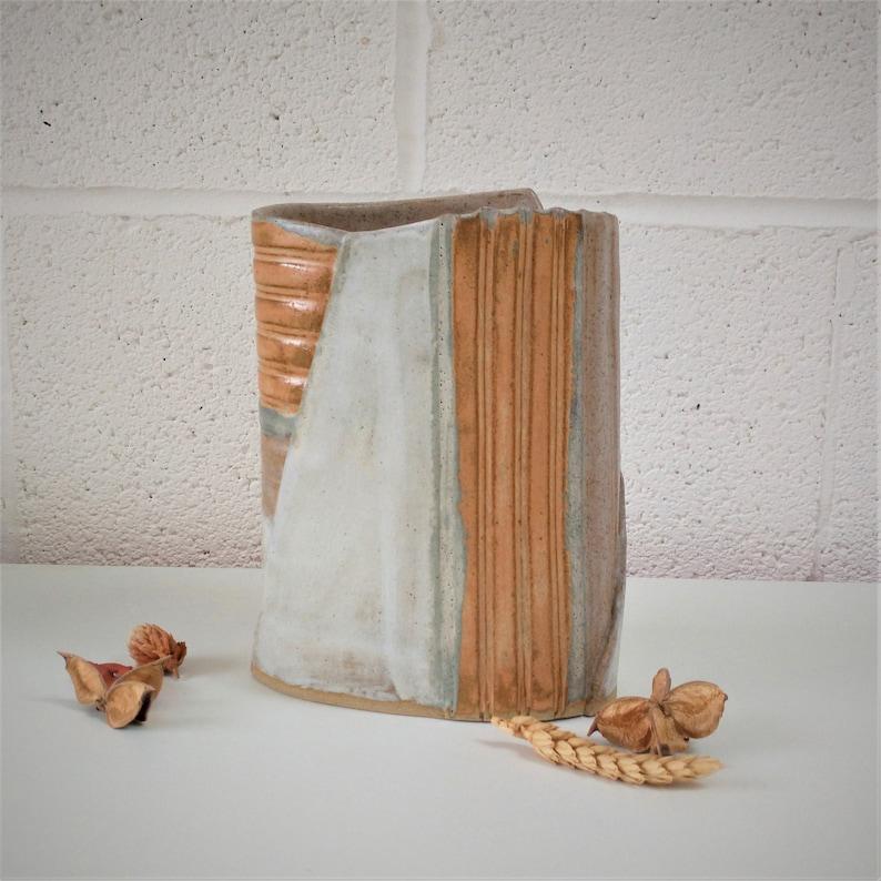 Ceramic vase with burnt orange cream beige decoration ideal image 0
