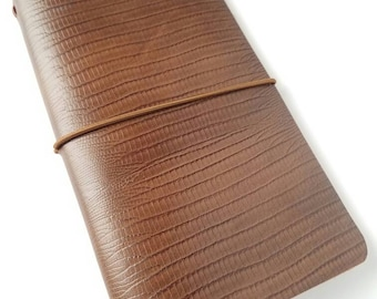 Fauxdori cover comes with fauxdori insert. Travelers notebook with an insert. Brown patterned leather journal.