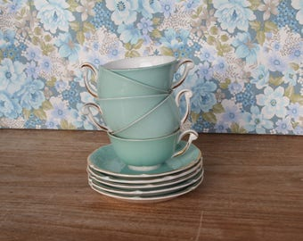Porcelain saucers with coffee cups. Green pastel and gold.  Made in France.  Vintage coffee service. Set of 5 coffee cups.