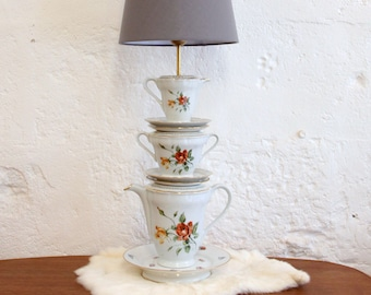 Lamp in old China, teacups, saucers, sugar... Tea cup, tea lamp