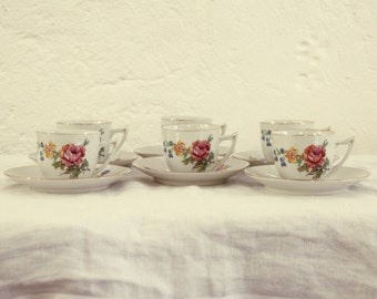 Old vintage porcelain coffee cups, coffee service, flower