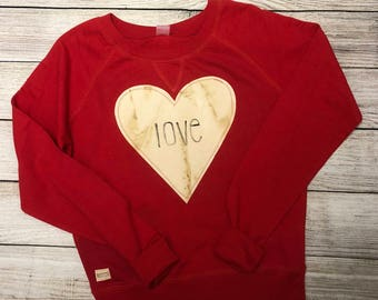 Red dolman terry sweatshirt with stamped love
