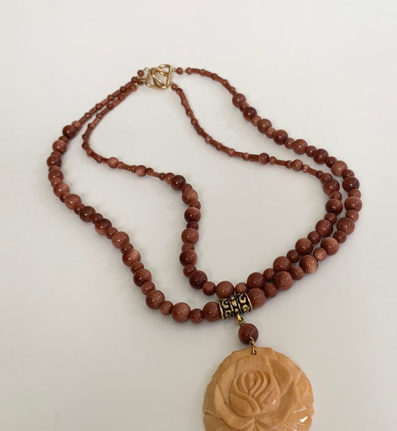 Goldstone Beaded Necklace Double Strand Beads with Carved Wood Rosette Pendant Vintage Necklaces Gold Tone Clasp