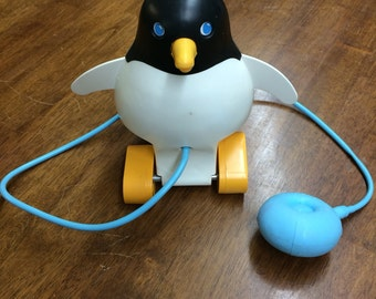 Fisher price penguin pull toy that squeaks